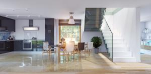 Modern kitchen with glass stair balustrade