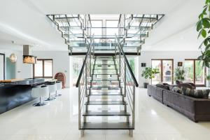 open plan home with glass and stainless steel stair handrails