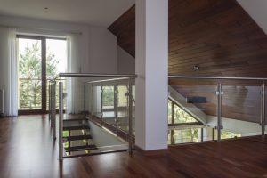 Glass balcony in attic